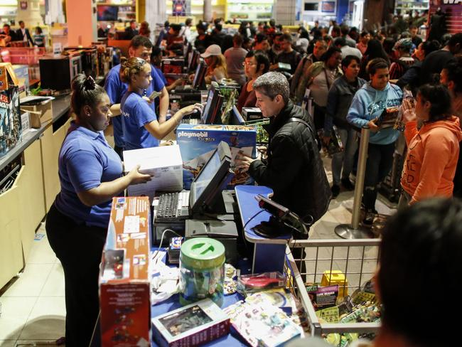 Shoppers pay for items at a Toys R Us in New York City. Picture: Getty