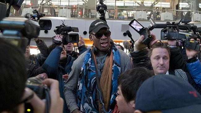 Former NBA star Dennis Rodman arrives at the capital airport for a flight to North Korea, in Beijing, China on Thursday December 19.