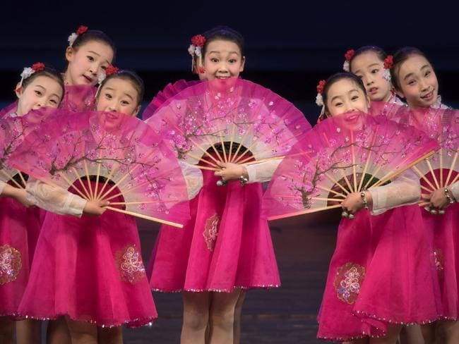 Children perform a variety dance and music show during an organised tour of the Childrens Cultural Palace. Picture: AFP
