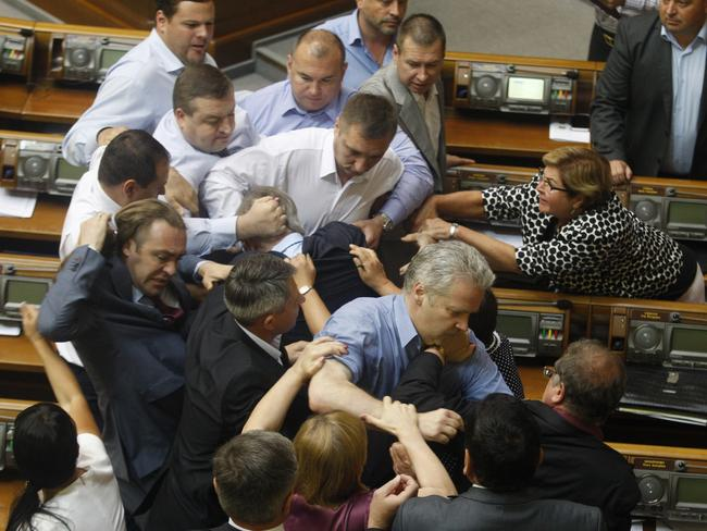 "Game on ... Deputies of the All-Ukrainian Union ""Svoboda"" party attack the head of the Communist parliamentary faction Petro Symonenko (C)."