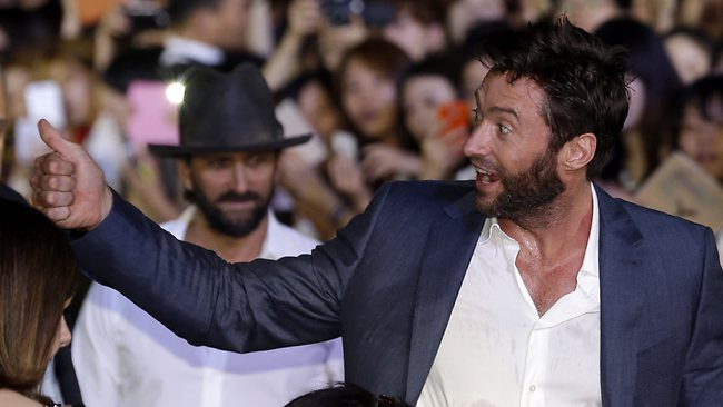 Actor Hugh Jackman gives a thumbs-up to his fans. Picture: AP