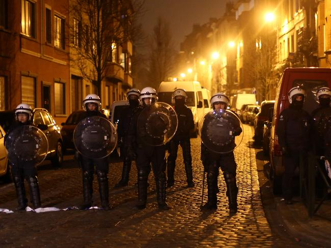 Police officers guard a road after raids in which several people, including Paris attacks suspect Salah Abdeslam, were arrested. Picture: Getty