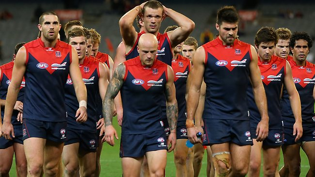 MELBOURNE, AUSTRALIA - MAY 12: The Demons look dejected after losing the round seven AFL match between the Melbourne Demons and the Gold Coast Suns at Melbourne Cricket Ground on May 12, 2013 in Melbourne, Australia. (Photo by Quinn Rooney/Getty Images)