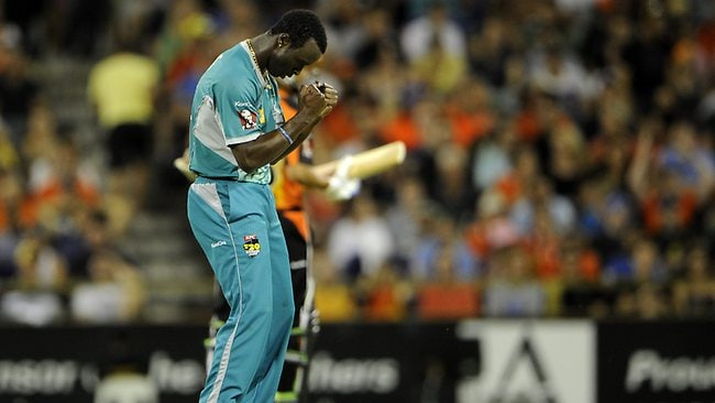 Brisbane's Kemar Roach celebrates the wicket of Simon Katich, out for a duck. Picture: Daniel Wilkins