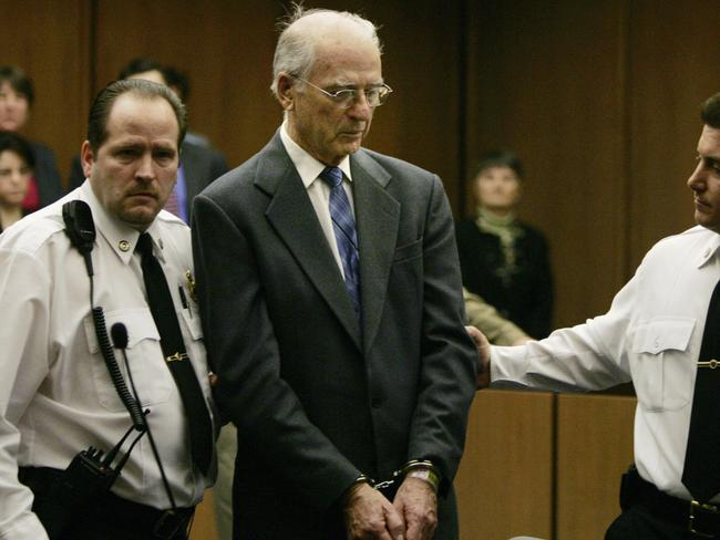 In this Feb. 15, 2005 file photo defrocked priest Paul Shanley is led from Middlesex Superior Court in Cambridge, Mass. in handcuffs. Picture: AP.