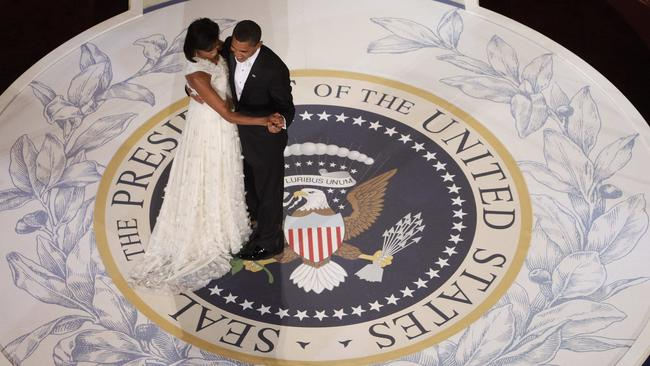 Obama and first lady Michelle Obama dance at the Commander in Chief Inaugural Ball at the National Building Museum in Washington in 2009. Americans remain deeply divided over his legacy. Picture: Charles Dharapak/AP