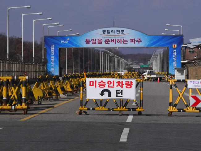 A barricade is set on the road leading to the truce village of Panmunjom at a South Korean military checkpoint in the border city of Paju near the Demilitarized Zone (DMZ) dividing the two Koreas. Picture: AFP
