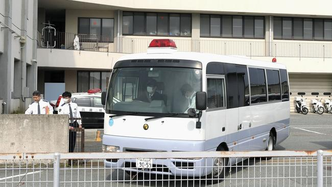 A police vehicle carrying arrested Japanese Yoshitane Yamasaki leaves Sanda Police Station. Picture: Yohei Nishimura/Kyodo News via AP