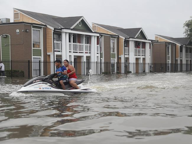 A Jetski is used to help people evacuate homes after the area was inundated with flooding from Hurricane Harvey on August 27. Picture: Joe Raedle/Getty Images/AFP