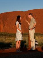 Their Royal Highnesses the Duke and Duchess of Cambridge, Prince William and Duchess Kate watch on as the sunsets on Uluru. . Picture Gregg Porteous