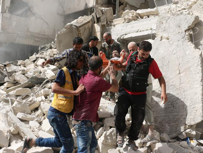 Syrians remove a victim from the rubble of a destroyed building following a reported air strike in the Qatarji neighbourhood of the northern city of Aleppo on September 21. Picture: Ameer Alhalbi/AFP