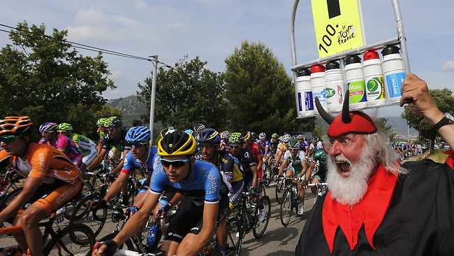 """""""El diablo"""" cheers riders in the pack during the 228.5 km fifth stage of the 100th edition of the Tour de France."""