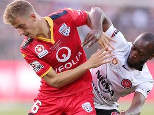 Stefan Mauk of United is tackled by Romeo Castelen of the Wanderers during the A-League Grand Final between Adelaide United and the Western Sydney Wanderers at Adelaide Oval in Adelaide, Sunday, May 1, 2016. (AAP Image/James Elsby) NO ARCHIVING, EDITORIAL USE ONLY