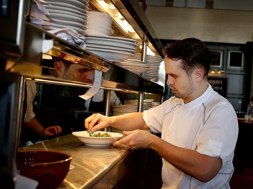 The chief executive chef for Jamie Oliver Australia, David Clarke, oversees the meal service . Picture: Mike Burton
