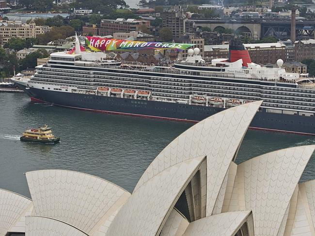 Cunard paid tribute to Sydney's Mardi Gras by dressing up the Queen Elizabeth which cruised into the harbour with Miss Vanity Faire on the bow.