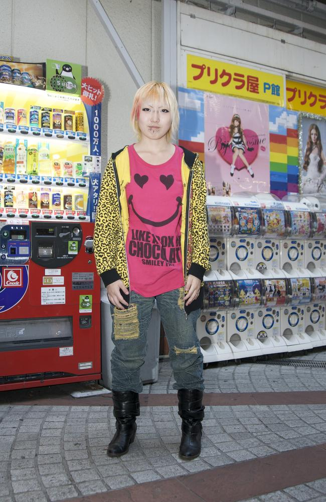A young Japanese woman shopping in the Harajuku area.