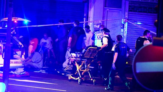 Ambulance and police officers tend the injured. Picture: REX/Shutterstock