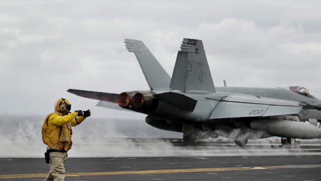 An FA18 is catapulted off the flight deck on the USS George Washington Aircraft Carrier. Picture: Jeff Camden