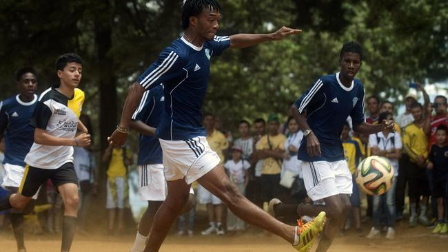 Colombia star Juan Guillermo Cuadrado in action during a charity football match.