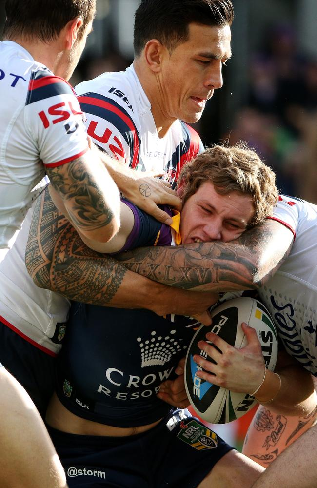 Kurt Mann gets a squeeze from Sonny Bill Williams.