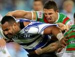 Bulldog's Tony Williams attempts to bust the tackle of South Sydney's Sam Burgess during the NRL game between the Canterbury Bankstown Bulldogs and the South Sydney Rabbitohs at ANZ Stadium. Picture Gregg Porteous