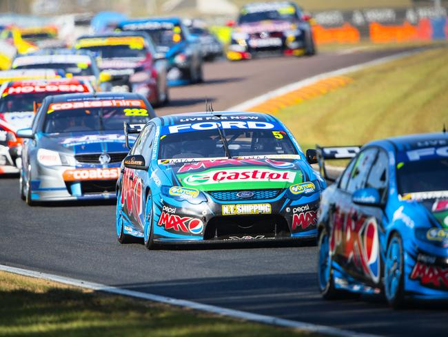 Mark Winterbottom (C) drives for Ford during the V8 Supercars race at Hidden Valley in Darwin.