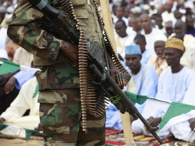 Brutal ... A Nigerian soldier stand guard during Eid ul-Fitr celebrations in Maiduguri, Nigeria. Picture: AP