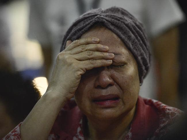 A woman reacts after hearing about the tragedy at Kuala Lumpur International Airport in Malaysia. Picture: AP