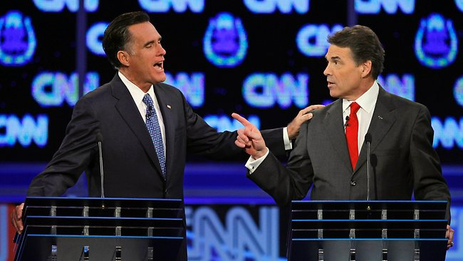FOR USE IN YEAREND EDITIONS - FILE -In this Oct. 18, 2011 file photo, Republican presidential candidates former Massachusetts Gov. Mitt Romney, left, and Texas Gov. Rick Perry speak during a Republican presidential debate in Las Vegas. (AP Photo/Chris Carlson, File)