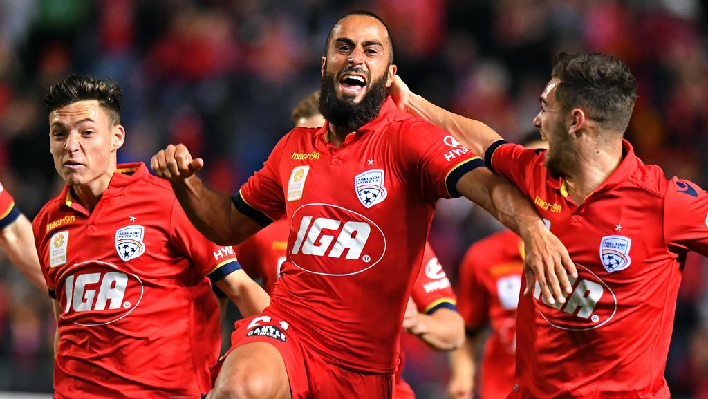 Adelaide United's Tarek Elrich celebrates with teammates after scoring a goal. Picture: Tom Huntley