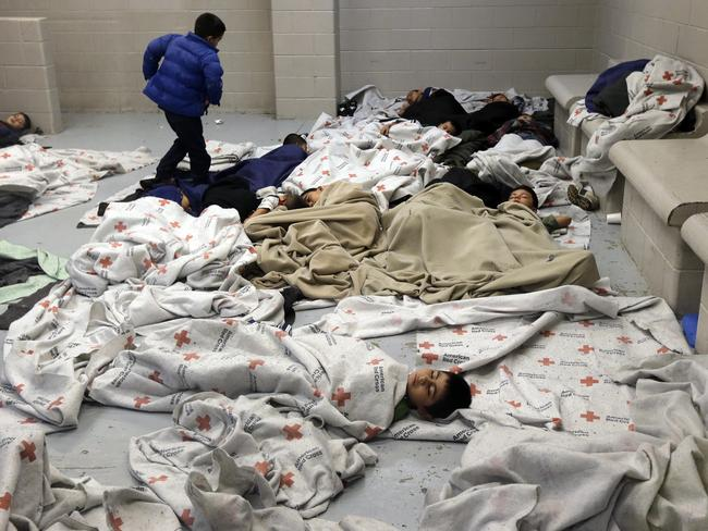 Locked up ... detainees sleep in a holding cell at a US Customs and Border Protection processing facility in Brownsville, Texas. Picture: Eric Gay