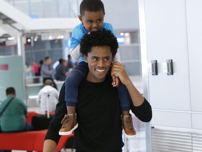 Olympic silver medallist Feyisa Lilesa, of Ethiopia, carries his son Sora.Source:AP via news.com.au