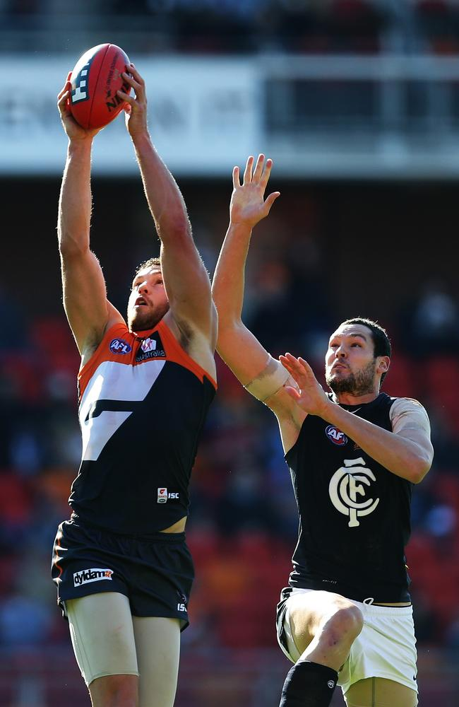 Greater Western Sydney's Shane Mumford takes a mark over Carlton's Robert Warnock during the GWS Giants v Carlton AFL match at Spotless Stadium, Homebush. Pic Brett Costello