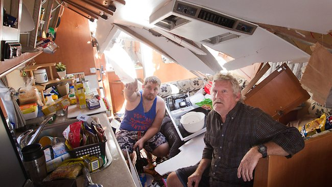 A series of tornadoes has ripped through the Denison caravan park in Mulwala, NSW. Right to Left - Keith Corney and his son, Travis were inside thier caravan when a tree fell on it and forced the roof to collapse. Picture: Chris Scott