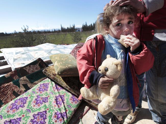 A Syrian child is seen with her family who fled from Qusair, near Homs, at the Lebanese-Syrian border. Picture: AP