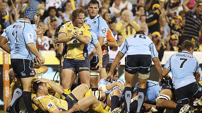 Dan Palmer of the Brumbies celebrates a try by Ben Mowen during the round four Super Rugby match between the Brumbies and the Waratahs at Canberra Stadium.