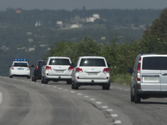 Access denied ... a convoy of the OSCE mission set off, pictured on July 30. Picture: Dmitry Lovetsky
