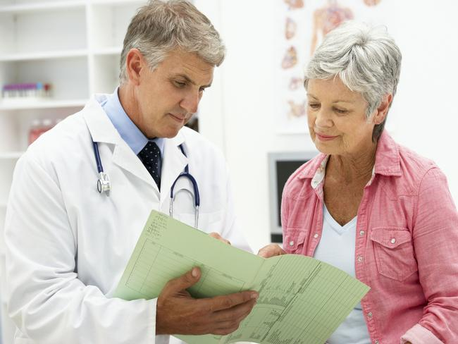 $7 GP fee rises dead in water ... A doctor discusses his notes with a patient. Picture: Thinkstock