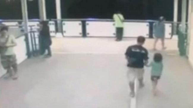 CCTV footage from a Bangkok train station shows six-year-old Nong Cartoon being led away by a suspect identified as 'Nui'.