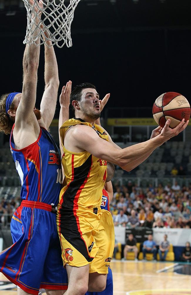 Chris Goulding with a reverse lay-up in front of Adelaide's Luke Schenscher. Picture: Geo