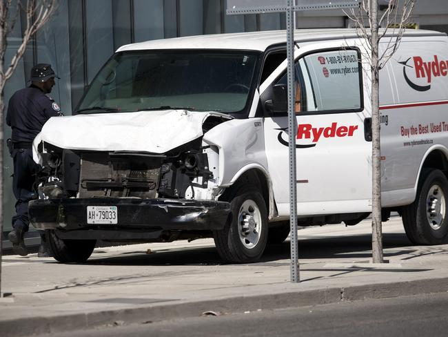 A suspect is in custody after a white van collided with multiple pedestrians. Picture: Cole Burston/Getty Images/AFP