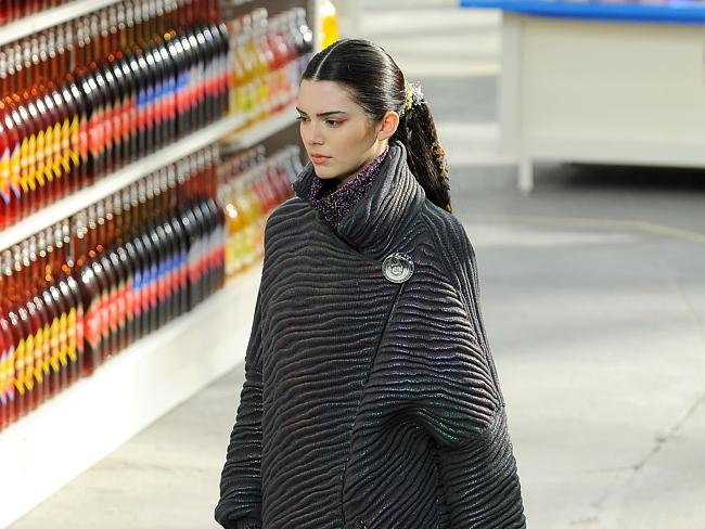 Keeping up ....Kim Kardashian's baby sister Kendall Jenner walks the runway during the Ch