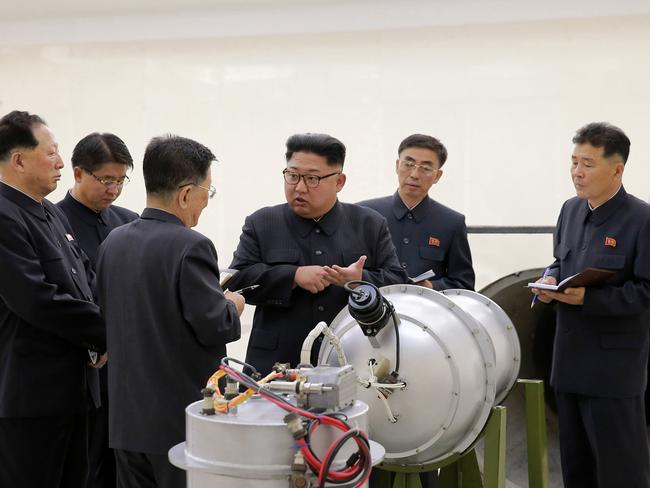 Kim Jong-un inspects the loading of a hydrogen bomb into a new intercontinental ballistic missile. Picture: Korean Central News Agency/Korea News Service via AP