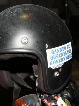 "A ""Banned by the Queensland Government"" sticker."