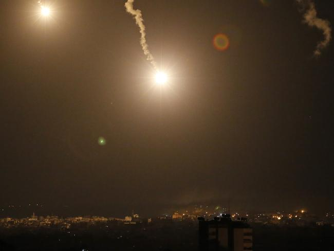 Flares light the sky over Gaza City, in the northern Gaza strip, as Israel launched a large-scale ground offensive. It was the first major Israeli ground offensive in Gaza in over five years. Picture: AP/Lefteris Pitarakis