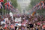<p>Well wishers with flags surge along the Mall towards Buckingham Palace to celebrate the Royal Wedding of Prince William, Duke of Cambridge and Catherine, Duchess of Cambridge at Westminster Abbey on April 29, 2011 in London, England. Picture: Christopher Furlong/Getty Images</p>
