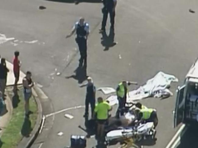 Emergency crews at the scene in Rosemeadow where Michael Hannon was killed. Picture: 7 news