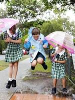 They can jump puddles: Narangba State School students Daisee Bishop, Sam Holmlund and Summer Bishop have fun in the wet. Pic: Andrew Seymour