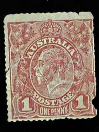 A World War 1 penny stamp and its message on the back.