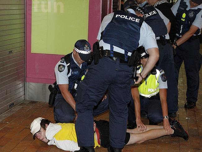 Police detaining a party-goer. Photo: Jerad Williams.